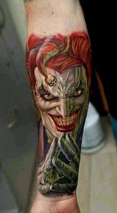 Joker tattoo by Dmitriy Samohin, evil jester, grin, clown, skull, arm wrist tattoo