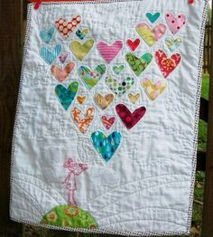 A quilt (that's actually cute) made from old baby clothes you can't bare to part with but no longer fit!