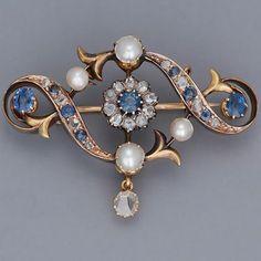 Sapphire, diamond, pearl and gold brooch. #GoldBrooches