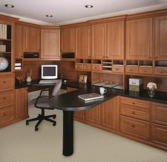Prestige office in a Okanagan Cherry finish Melamine with leg supported peninsula, Deco doors and drawers, and traditional top and bottom molding.
