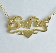 When you want to be thrilled or thrill someone else, here's the perfect gift:… ************************************************************************************** Name Necklace / Personalized Gold Name Necklace / for her Gift HNG048 You can choose any name . All you have to do is to send a Note to seller when you checkout Pendant: Length: (2.5cm) Width: (1cm) Metal: Chain: 14k Gold filled Pendant : 14k Gold plated over brass (nickel free) Finishing: Shiny gold In the case ...