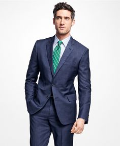 Two-button suit made from pure wool woven in Italy. Our 1818 Suits feature framed interior pockets to eliminate stress points, hand sewn upper arm hole for added comfort and movement. Bemberg lining. Crafted in our Regent fit, with slimmer lines, narrower lapels and a shorter jacket. Center vent. flat-front trousers. Dry clean. Made in the USA.