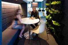 Jones Lang LaSalle's Sydney HQ created by Futurespace features an understair nook for quiet meetings. It comprises banquet seating, acoustic walls and greenery to create an inviting sp...