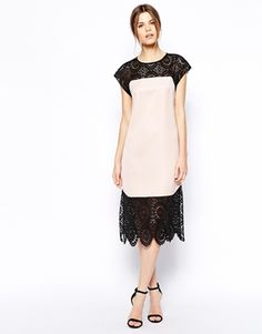 Great edgy dress to wear to a wedding. Accessories will determine how dressy. Great for column or straight body shapes. Be sure to wear a heel to keep it from looking matronly.