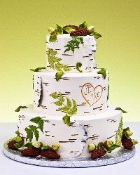 """Birch tree wedding cake... Love how the bride and groom's initials are """"carved"""" into the tree! And the peeling pieces of bark with the darkness beneath (I can't tell but I hope the """"peeled"""" spots are that nude color as in real life) are just perfection! Ferns etc are icing, acorns and pinecones are molded chocolate."""