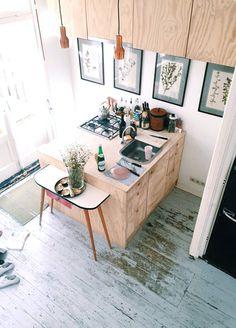 skinny copper pendant lamps in Amsterdam apartment via designlovefest. / sfgirlbybay