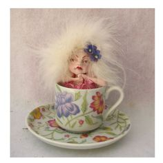 Tea Leaf Fairy in a Floral Cup and Saucer  http://cgi.ebay.com/ws/eBayISAPI.dll?ViewItem=150833096961