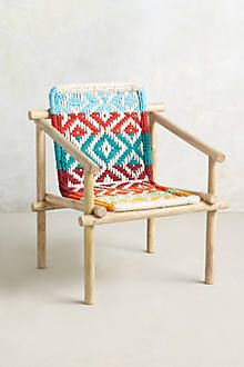 Diamond Weave Chair at Anthropologie. I'm quite sure I have a book explaining how to fabricate this pattern.