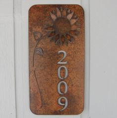Rusty Finish Metal Wall Art Sunflower Address Plaque House Number Sign by MountainIron on Etsy https://www.etsy.com/listing/125434112/rusty-finish-metal-wall-art-sunflower