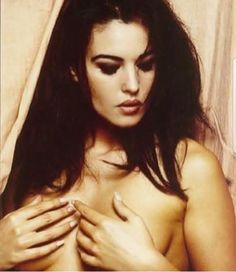 Nude monica bellucci sunbathing
