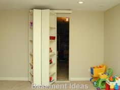 Hinged bookcases hiding a doorway - open=brilliant!