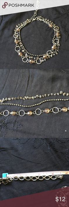 "3-strand choker 15"" long with 3.5"" extender, this necklace is antique silver with bronzes looking beads, rings and crystals.  Really different and pretty!  EUC Jewelry Necklaces"