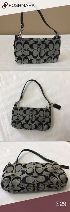 Signature Black & Gray Coach Wristlet Black and gray Signature jacquard wristlet with zip closure and silver hardware. Mauve colored interior lining. Hang tag. Great used condition. Coach Bags Clutches & Wristlets
