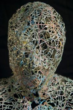 Artist Nikki Rosato creates these incredibly delicate busts using the mesh from cut-out street maps.
