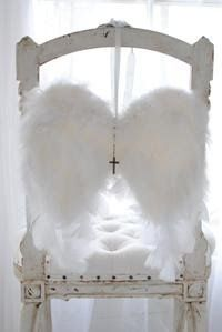 For those that are gone, a pair of angel wings on chair!