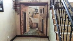 Imagine having a door to another time. The creation of a door to another place, a hand painted corridor leads you down a stone road into an aged and classical city. is this possable? Stone Road, Corridor, Corporate Events, Addiction, Stairs, The Incredibles, Hand Painted, City, Places