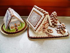 Gingerbread houses in the European tradition by Dalla Via Jana, posted on Cookie Connection. One is decorated in springtime colors and style, and one is decorated in the Christmas tradition.