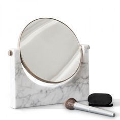 designstuff offers a range of Scandinavian designed homewares including this stunning minimalist PEPE marble mirror in white and brass by Menu.