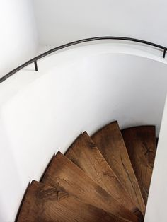 Spiral stairway with black metal handrail and wooden treads. Restaurant of At The Chapel. Photo by Rich Stapleton.