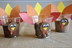 Emmy will use craft feathers and chocolate pudding cups for thanksgiving gifts for her preschool classmates!  Thanksgiving Turkey Snack Cups idea ... clever
