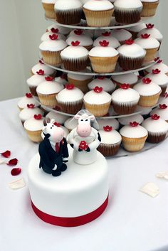White & Red Blossom Wedding Cakes with Cow Toppers by ConsumedbyCake, via Flickr