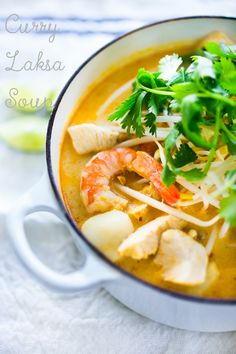Coconut Laksa Soup w/ Chicken and Shrimp over rice noodles.... Slurp slurp!    www.feastingathome.com