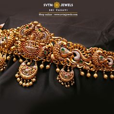 Feel the bliss of this gold oddiyanam/vadanam enlightened with the sculpt of Goddess Lakshmi and peacock on Two sides.This oddiyanam Studded with Cubic Zircone,Swarovski Pearl and Ruby Stones. This does not include the back belt, please contact cu Gold Jewelry Simple, Gold Rings Jewelry, Pendant Jewelry, Unique Jewelry, Gold Pendant, Jewelry Bracelets, Antique Jewellery Designs, Gold Earrings Designs, Gold Jewellery Design