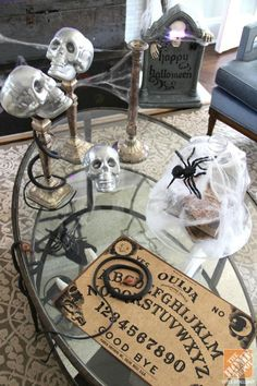 Want to decorate your home for a Halloween party? First, shop your house for things you already have, like maybe a Ouiji board from your game closet or a fake snake from the playroom! #repurposed