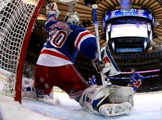 NEW YORK, NY - MAY 29: Henrik Lundqvist #30 of the New York Rangers makes a save in the second period against the Tampa Bay Lightning in Game Seven of the Eastern Conference Finals during the 2015 NHL Stanley Cup Playoffs at Madison Square Garden on May 29, 2015 in New York City. (Photo by Elsa/Getty Images)