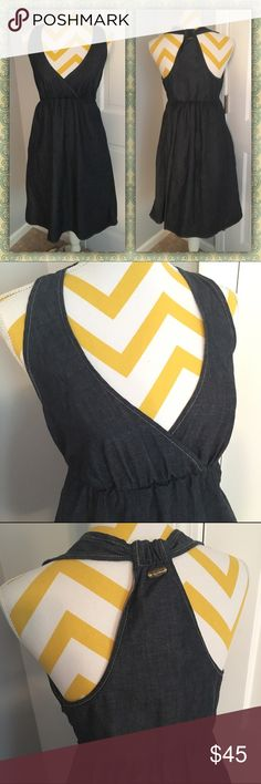 """NWOT k.Roque Denim Dress NWOT K.Roque Dark denim dress. This is not one to pass on! I bought this dress from a fashion house in California. Unfortunately, I doesn't fit (crying)! Deep V halter like top. Elastic bust line with T back. Side hidden zip closure. Perfect weight denim. You won't be disappointed and so well made‼️❤️ 37"""" Length K.Roque Dresses Midi"""