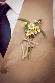 cute simple boutonniere wrapped in twine