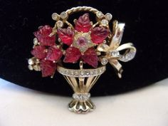 Fall in love with this very Rare Coro Craft Flower Basket pin featuring gorgeous Molded Red Glass rhinestones accented by diamante rhinestones in