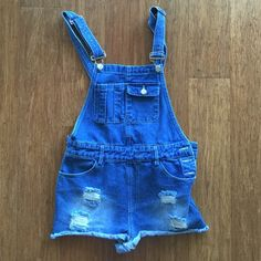 Gypsy Denim Jumper Crossed back. Front pockets. Button ups on the side. Other