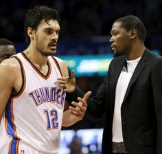Oklahoma City's Kevin Durant (35) greets Steven Adams (12) during a timeout in an NBA basketball game between the Oklahoma City Thunder and the Atlanta Hawks at Chesapeake Energy Arena in Oklahoma City, Friday, March 20, 2015. Oklahoma City won 123-115. Photo by Nate Billings, The Oklahoman