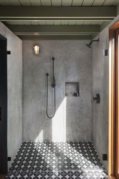 Bath Room, Cement Tile Floor, Wall Lighting, Full Shower, and Enclosed Shower The concrete tile transitions into the plaster shower for a seamless look. Photo 9 of 11 in Garner Pool & Casita
