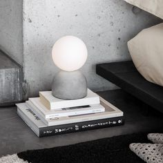Table lamp with round cement foot and opal colored glass cover. The cement foot has a full cover underneath so not to scratch the substrate. Light source not included. Paper Balls, Opal Color, Scandinavian Interior Design, Surabaya, Home Lighting, Colored Glass, String Lights, Light Up, Glass Vase