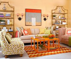 What a cheerful space! This living room was updated to serve as a guest bedroom and office. Click here to tour the rest of the room: http://www.bhg.com/rooms/living-room/makeovers/orange-living-room/#page=3