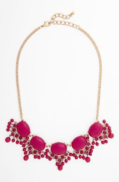 This fuchsia crystal and bead statement necklace is perfect for dressing up a jeans and tee combo.