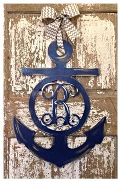 "Ahoy Mate!  This beautiful and unique anchor door hanger is primed, hand painted, and made using 1/4"" wood.  Perfect for interior or exterior use.  Measures 28"" tall and features an initial in the center.  Initial cut using the interlocking font.  Each piece is hand painted and distressed to give it a 3 dimensional look.  Bow included as shown.  Orders take up to 4 weeks."