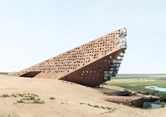 Nestled in the Mongolian desert, the concept of the future Yellow River Hotel in Jungar Banner looks like a gigantic piece of rock embedded in the sand of the desert.