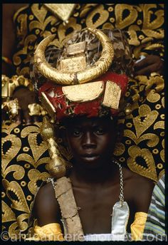 """Africa   Ashanti """"Soul Bearer"""" guards his chief bedecked in ceremonial finery of golf amulets, feathers and a gilded rams horn headdress. Ghana   ©Angela Fisher and Carol Beckwith (African Ceremonies)"""