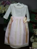 Half skirt or baton pink pique body with gorgeous lace and ties in dark beige.  Waist