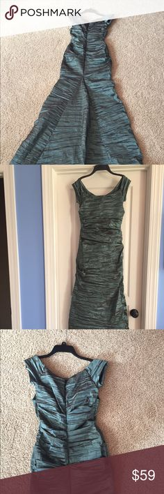 Evening gown Teal with iridescent hues.  Crinkle material with stretch. SO comfortable and easy to sit it.  Fish tail back.  Floor length for 5'4.  Would be ankle length in front with floor length back for taller person.  Looks great both ways. Alex Evenings Dresses Maxi