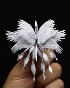 Art - Crane (Bird) Cristian Marianciuc is an artist of origami! He challenges himself every day and creates some wondeOrigami Art - Crane (Bird) Cristian Marianciuc is an artist of origami! He challenges himself every day and creates some wonde Kirigami, Origami Paper Art, Origami Cranes, Paper Cranes, Origami Flowers, Origami Artist, Origami Butterfly, Origami Folding, Paper Folding
