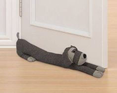 a draught excluder to block the gap under your door. Make a draught excluder to block the gap under your door. Door Draught Stopper, Draft Stopper, Door Stopper, Sewing Toys, Sewing Crafts, Sewing Projects, Door Draft, Sew Ins, Fabric Crafts