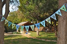 Birthday banner in shades of blues and greens