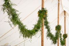 A Wilde Bunch hanging garland spanning the entire length of a Marquee at Yarlington House. A 25 meter span. Hanging Garland, Marquee Wedding, Plant Hanger, Canopy, Wedding Flowers, Wreaths, Weddings, Garden, Plants