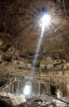 This domed government building in Baghdad, formerly a part of Saddam Hussein's regime, was hit by a 5,000 lb (2,300 kg). bomb.[1] Apart from the hole made by the entry of the bomb, it remained structurally sound.