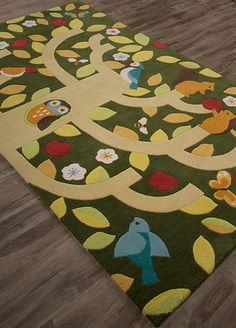 The trees are a-flutter with favorite forest friends. This unique rug design adds a story to any children's space. In hand-tufted poly, with a gentle, rustic color palette accented by warm pops of red.