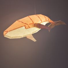 Our Humpback Whale paper lamp consists of a papercraft kit for you to build the model. Either with friends or individually, enjoy bringing to life one more member at your home. Make sure to take a few hours to assemble your Humpback Whale paperlamp – best results always require some dedication! This paperlamp is a DIY papercraft kit, including a pre-cut paper model and a ceiling light fixture with an E27 light bulb socket and 1,0-meter long electrical cable. Also included is an assembly guide an Electrical Cable, Fish Lamp, Origami Models, Paper Light, Humpback Whale, Cut Paper, Paper Models, Family Gifts, Light Fixtures
